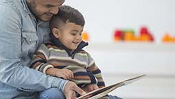 father reading to child