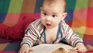 Baby reading a book