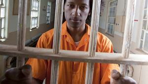 Young African American Man Behind Bars