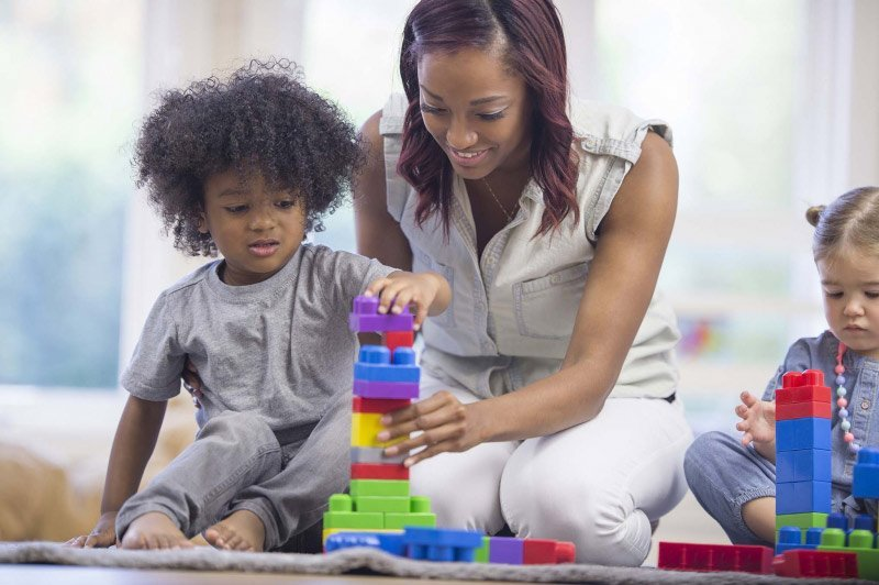 mom kids and building blocks