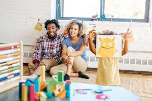 parents with child in playroom